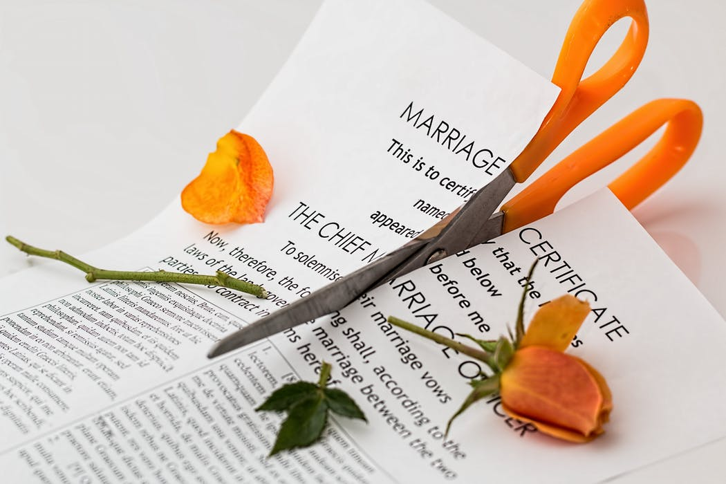 marriage certificate and a pair of scissors